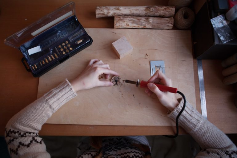 pyrography artist working
